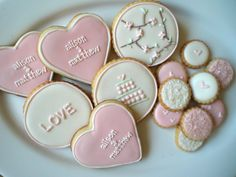 "Wedding/Engagement Gift Set that includes: 1 dozen ""button"" cookies with mini heart and glitter designs, heart shaped cookies personalized with couples' names, and circle shaped cookies with various designs.   Matching rings"
