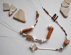 Noha Nicolescu necklace with cinnamon, pearls, corals and wood