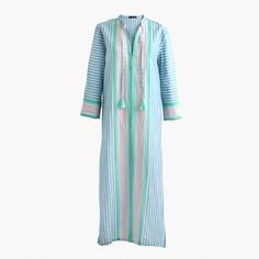 The caftan has literally been around since 600 B.C., so if that isn't a testament to its staying power, then we don't know what is. Our 2017-take is breezy and ideal for every vacation activity—from beach walks to casual seaside dinners. Falls above ankle. 48 1/2 from high point of shoulder (based on size small). Loose fit. Linen/cotton. Three-quarter sleeves. Machine wash. Import. Online only.
