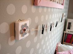 picture hanger... & I like the idea of just the squares with the knobs on them to hang necklaces on
