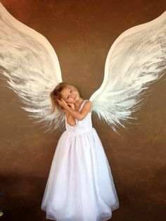 """My beautiful grandbaby Lydia Monroe :)  A wonderful woman Sonja McSwain painted these angel wings on outside wall of our store De'France Indoor Flea Market Antiques & Collectibles :)  230 Eglin Pkwy Ft. Walton Beach FL. 850-314-7500  """"Like"""" us on FB"""