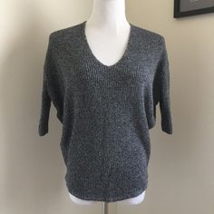 Grey Dolman Sweater Knit dolman sweater. Gently worn but no damage or flaws. Perfect with leggings and boots! Size S Sweaters V-Necks