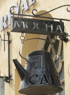 Another pinner said: Good name for a coffee shop. Love the sign with the coffee pot. Great marketing.