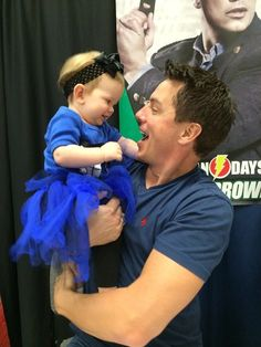 Love the Tardis outfit this little girl is wearing, plus this photo is too adorable [John Barrowman and The TARDIS]