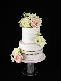 A lovely 21st birthday cake. It is caramel mud cake with vanilla buttercream and fresh flowers.