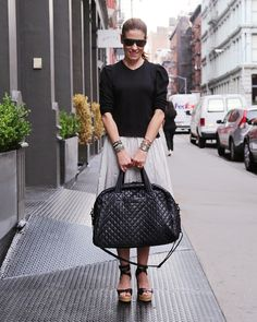 Lucy Wallace Eustice heads out for a summer weekend getaway with her Black Oxford Jim Bag