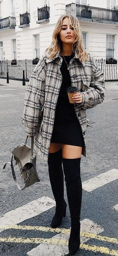 #spring #outfits woman wearing black mini dress and gray plaid coat holding gray leather bag crossing on street. Pic by @sophiemilner_fs