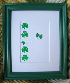 Cut out some green hearts, create a design and finish it off with a green frame.  (you could do the same thing for Valentines day, with pink or red as the theme color)