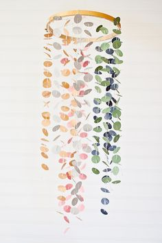 Love this sweet confetti dot mobile via A Subtle Revelry. Could use paint chips and customize for any ole occasion.