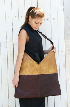 This is a brand new design that is very stylish and modern. It is a combination of two colors. The bag has adjustable handle that allows you to wear it differently.