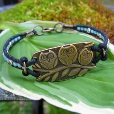 Bead Wrapped Brass Owl Bracelet / Cotton Cord and by TuppersPerch. $18.00, via Etsy.