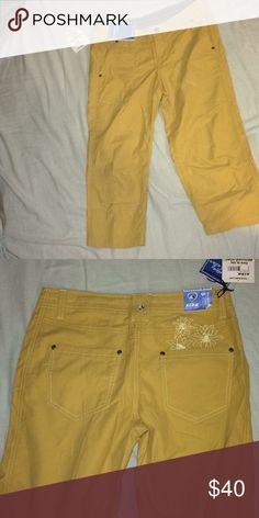 Capri hiking pants Never before worn mustard yellow Capri hiking pants with from and back pockets. Kuhl Pants Capris