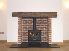 Reclaimed brick chamber with reclaimed clad oak beam, natural slate tiled hearth and Morso 2110 Panther wood stove fitted in Rayleigh Essex . Corner Gas Fireplace, Build A Fireplace, Country Fireplace, Vintage Fireplace, Inglenook Fireplace, Home Fireplace, Brick Fireplace, Fireplace Design, Fireplace Inserts