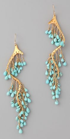These 18k gold-plated dangle earrings feature faceted turquoise beads at the chain fringe.