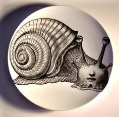 Charming Tema e Variazioni plate #260 by Italian designer Piero Fornasetti (1913-1988). 10.25 in. diameter. via Palazzetti