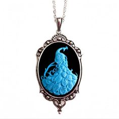 "Hand carved with meticulous care, the Peacock Necklace features a blue bird on a black resin background. The antique-style, silver-colored setting adds instant vintage appeal. Chain is silver-plated, 18"" in length. Cameo setting is approximately 2 ½"" long and 1 ¾ "" wide. Brand: Couture By Lolita Material: Silver Plating, Resin Color: Black, Blue"