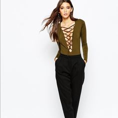 """Lace up bodysuit gently worn, no signs of wear. very figure flattering. tag says """"8"""" but fits a 4/6 ✨✨✨WILL TRADE IF SOMEONE HAS THIS IN BLACK✨✨✨ ASOS Tops"""