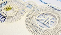 Embellished laser cut wedding invitation sleeve.
