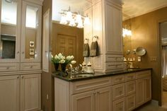 add a median cabinet with a drawer and 2 cabinets; drawers btwn vanities instead of doors.
