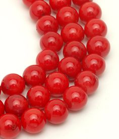 Coral Dyed 8mm Round.  Plentiful white coral from the Pacific dyed a variety of colors offers an economical and environmentally friendly alternative to rare or endangered naturally colored corals.