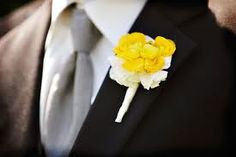 Yellow ranaculous boutonniere with ivory hydrangea