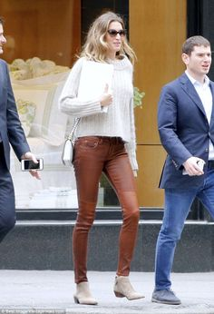 Supermodel physique: Gisele Bundchen, 36, put her seemingly endless legs on display in a pair of eye-wateringly tight leather trousers as she ran errands in New York City