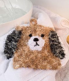 This friendly 2-Hour Puppy Scrubby is nice to have on hand by the sink or bathtub to make washing up more fun. You won't be able to resist this little guy's sweet face and this is an easy free knitting pattern that won't take long to complete. Kids will love using this knitted washcloth and it will definitely make doing the dishes more fun. The puppy is made in neutral colors, but you can get creative and work up a knit scrubby using any color combination you desire. If you love d...