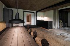 destilat Design Studio designed a stunning modern lounge in the former workshop of a historical Alpine chalet in Tyrol, Austria. Lounge Design, Old Wooden Chairs, Chalet Design, Interior Architecture, Interior Design, Design Studio, Wooden Flooring, Black Wood, Upholstery