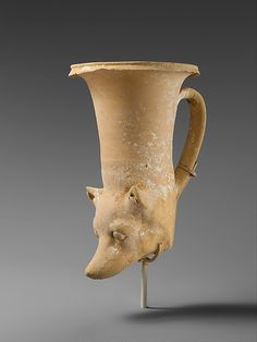 A Melitan. Note the pointed nose, short triangular spitz-type ears, and expressive eyes. This vessel appears to have been painted completely white, a typical Melitan colour. Terracotta Hellenistic rhyton from Apulia. Late 4th–early 3rd century B.C. Currently held at the Metropolitan Museum.