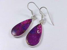 Sterling silver purple copper turquoise dangle earrings    Flat drops sterling silver earrings with vibrant purple copper turquoise gemstone and fine details throughout.