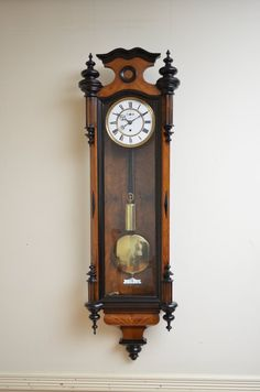 Victorian, figured walnut Vienna clock, having ebonised finials and canted corners with diamond decoration. The movement has been cleaned and serviced by a horologist and it is guaranteed for 12 months (UK mainland). Victorian Clocks, Antique Wall Clocks, Wood Clocks, Antique Lamps, Wall Clock Light, Diamond Decorations, Unusual Clocks, Cheap Pendant Lights, Clock Decor
