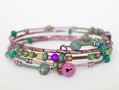 Items similar to Boho style beaded wrap bracelet in green, brass and pink beads, picasso beads, jingle bell charms, 4 wrap memory wire + charity donation on Etsy Beaded Wrap Bracelets, Donate To Charity, Jingle Bells, Boho Fashion, Picasso, Boho Style, Charmed, Brass, Unique Jewelry