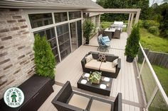 This beautiful elevated deck looks over an adjacent wooded lot. The furniture adds lots of area for guest seating making this the perfect place for a summer's night gathering