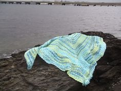 """A comforting crochet, this shawl was designed as a gift for a friend who was going through a difficult time. Crocheted using 100% wool in a soft heathered pink, this shawl works up fast using simple chains and increases to create a """"modern lace knit"""" shape. Make one for yourself or for a friend who may just need a little comfort in her life. Click here for the pattern: http://kountingsheep.com/2011/04/13/annas-shawl/"""
