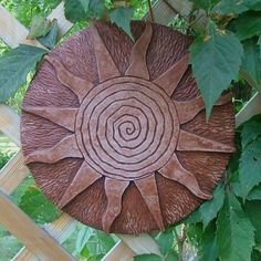 Spiral Sun Terracotta by mygardengoddess - I want this! Can see it in a dozen places