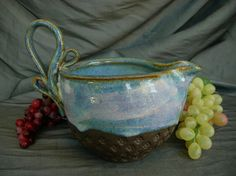 Small mixing bowl. Perfect for mixing sauces or scrambling eggs... Also makes a nice gravy boat. Wheel thrown. Check out that sexy handle. Pottery by Sally Anne Stahl