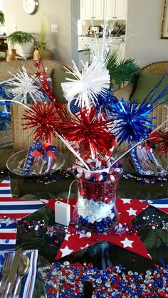 4th of July center piece.  Had the blue beads, the white/clear 2-16 from florist, red from Hobby Lobby red beads, pin wheels and strand of lights.  Burst from JoAnn's and another store 2016.  Flags Dollar tree, outdoor lights.  Top décor red and blue stars and bead Pier1 2016.