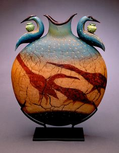 "Artist Selections - William Morris | Glass Artist//Reliquary Vessel, 1998  blown glass with steel stand  18""h x 15""w x 5""d"