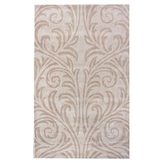 Beige rug with a scrolling motif.  Product: RugConstruction Material: WoolColor: Beige