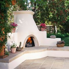 Patio Hearths Pueblo Traditions:   This distinctive fireplace evokes the traditonal Southwestern kiva style. The arched firebox, beehive shape, and stucco exterior are all reminders of the hearths that Pueblo people gathered around 2,000 years ago.