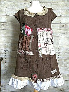 Boho rustic with a shabby touch. One of a kind country dress will make you feel oh so pretty with its unique beauty.  Floral artsy cardigan SWEATER dress duster. Brown cable knit pocket sweater. Buttons down front. Added lots of fabric patches, embellishments, and trims Wear with boots or sandals. Super cute! Layer over jeans.  Fits SIZE L XL Please check MEASUREMENTS to ensure a good fit. (May fit larger or smaller sizes depending on your body type)  2O across under arm LENGTH 36    Please…