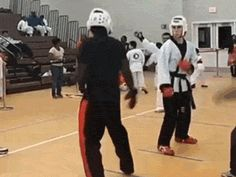 Vicious spinning hook kick in a taekwondo tournament. A counter to a step-in side kick to boot.