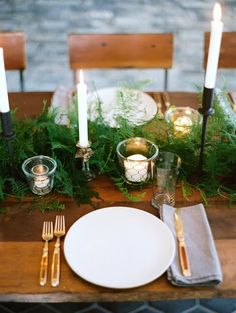 Basic White Dishes with candles and greenery laid down center