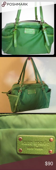 """Kate spade Nylon Stevie Green Satchel Great day bag with two external bottle or small umbrella pockets on either side of bag. 3 internal pockets. Navy jacquard lining with KS signature. 7"""" leather straps. Great condition. Smoke free pet free home 🏡 kate spade Bags Satchels"""