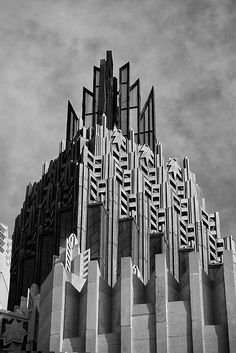 Art Deco building in Tulsa echoes the stylized floral pattern of the Craftsman-style fireplace tool handles elsewhere on this board.