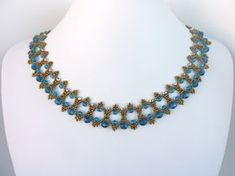 FREE beading pattern for an elegant necklace woven with 11/0 seed beads and round crystals to form a lovely embellished curved zigzag motif