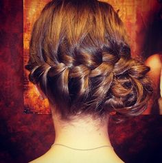 Braided to the side with a fun bun detail.