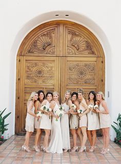 Mismatched neutral bridesmaids with some sparkle | Citrus Inspired Destination Wedding at La Quinta Resort