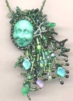 Green man face necklace