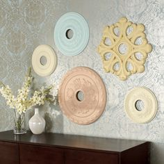 The ceiling medallions can be found in the lighting department of most home improvement stores and run anywhere from $14 to $50 depending upon the size.